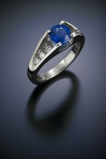 Held Above Sapphire Ring